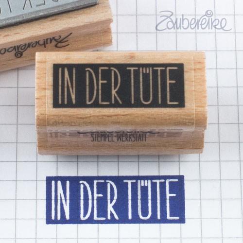 Textstempel In der Tüte in Satzschrift auf Farbfeld